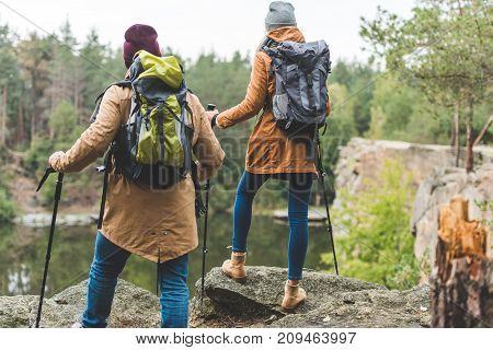 Couple Trekking In Autumn Forest