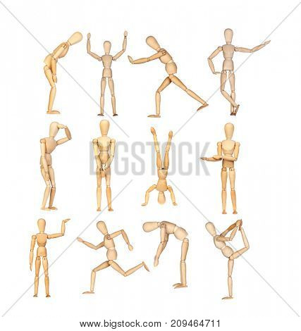 Many wooden mannequin doing different gestures isolated on a white background