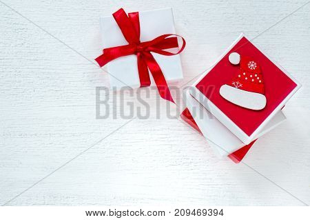 Boxes With New Year's Gifts Of Red And White Color. White Wooden Background.