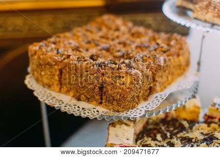 The wedding cake with nuts on the dessert stand