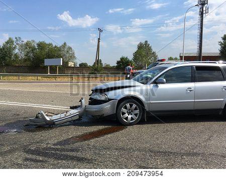 Car crash accident on street, damaged automobile, copy space