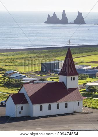 View from the top of Vic village the famous church and the black rocks Iceland