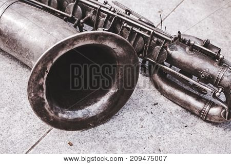 Close up of the old tenor saxophone in vintage look.