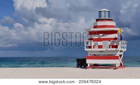A red and white striped beach rescue hut in Miami
