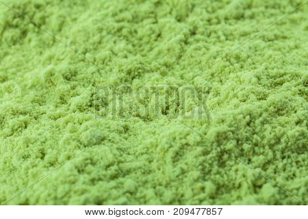 Nutrient-enriched wheat grass powder as background