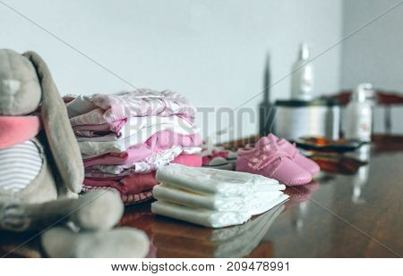 Female baby clothes ready for her arrival
