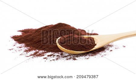 Acai powder and wooden spoon, isolated on white