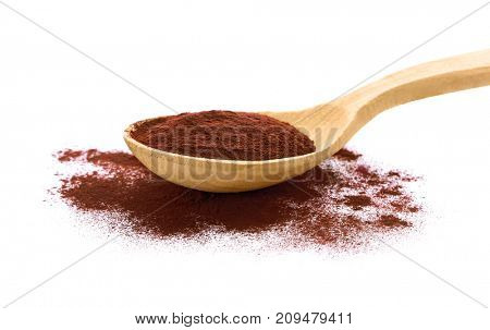 Acai powder in wooden spoon, isolated on white