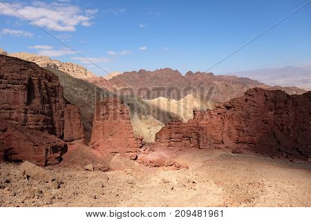 Red sandstone rocks on scenic trail in Eilat Mountains Israel.