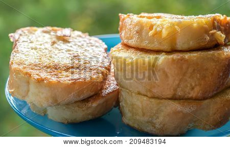Fried croutons toasts in a plate in butter