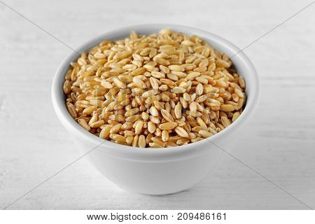 Bowl of wheat grass seeds for sprouting on table