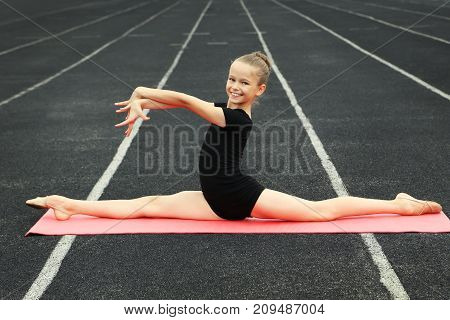 Young Girl Gymnast On Pink Fitness Mat