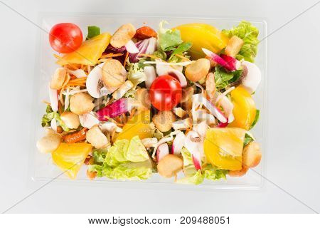 Salad In Takeaway Container On White Background In Top View