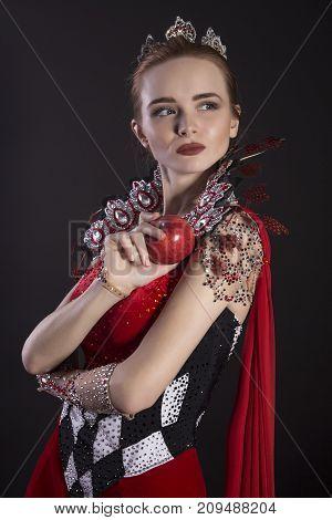 Portrait of a gorgeous queen. Halloween costume. Studio shot.