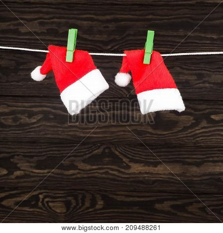 Christmas Decorations, Two Caps Of Santa Claus On The Clothespin
