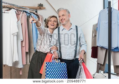 Woman Showing Something In Store