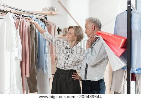 Woman Showing Shirt To Man