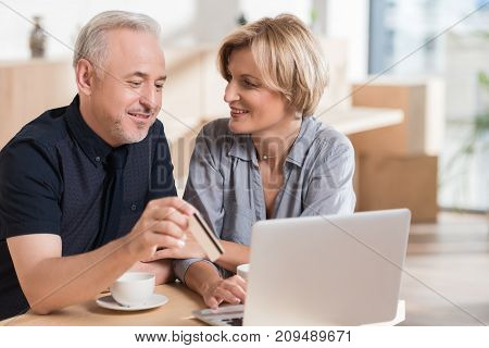 affectionate couple wanting to buy something online and pay with credit card