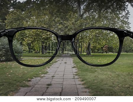 Clear Vision Through Glasses On Green Park Background