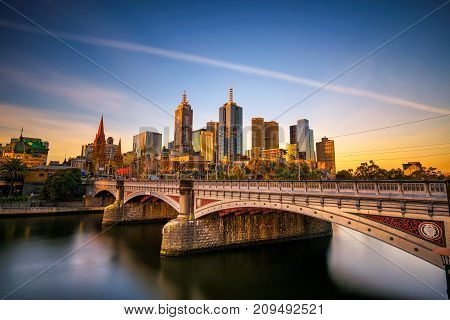 MELBOURNE, VICTORIA,  AUSTRALIA - JANUARY 28, 2017 : Sunset over city skyline of Melbourne downtown, Princess Bridge and Yarra River. Long exposure.