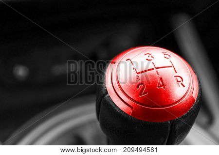 Abstract view of a gear lever manual gearbox car interior details. Black and white red