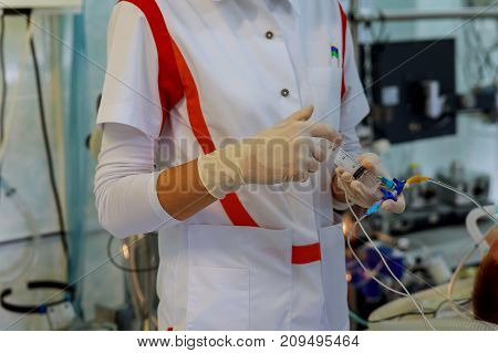 Woman is injected into the vein for patient with elderly room of the hospital. The nurse will inject the medicine into the system