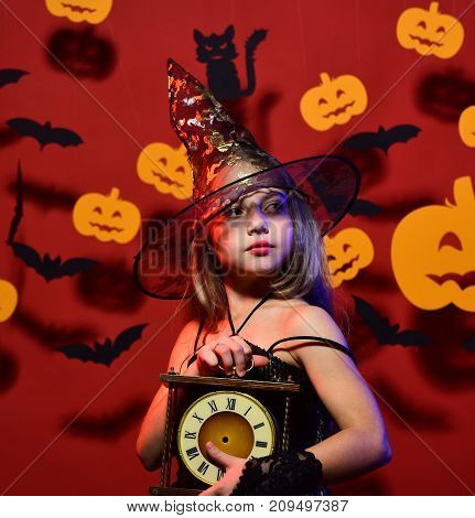 Little Witch Wearing Black Hat. Kid In Spooky Witches Costume