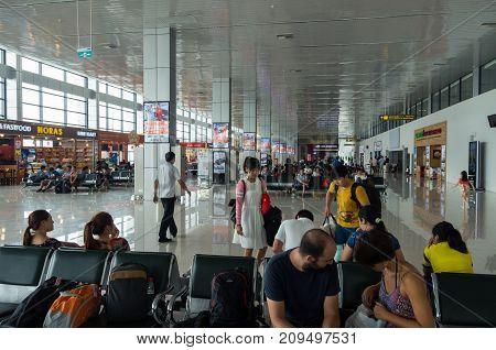 Hanoi, Vietnam - August 19, 2015: travellers inside the terminal of Noi Bai International Airport in Hanoi.
