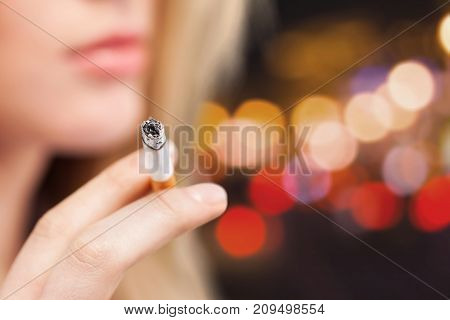 Girl cigarette smoking color background horizontal close-up