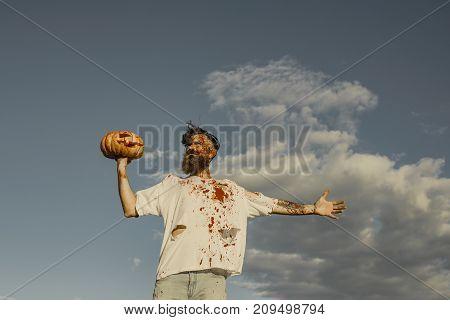 Halloween Man Holding Pumpkin On Hand