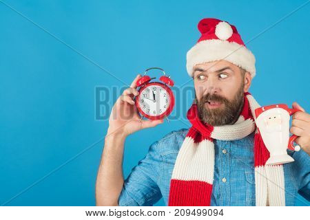 Christmas Hipster In Santa Hat, Scarf Surprised On Blue Background