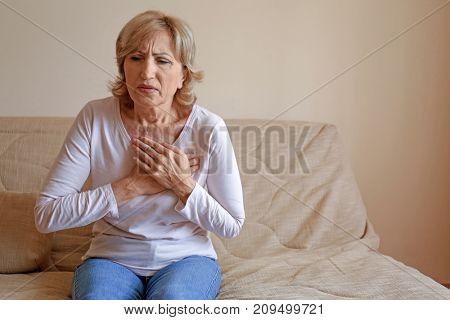 Woman having heart attack at home