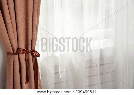 Window with beautiful curtains indoors
