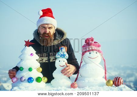 Angry Hipster In Santa Claus Cap On Winter Day