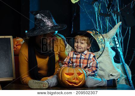 Halloween Man And Child In Witch Hat.