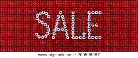 Word SALE is made rhinestones crystal color on a red canvas background