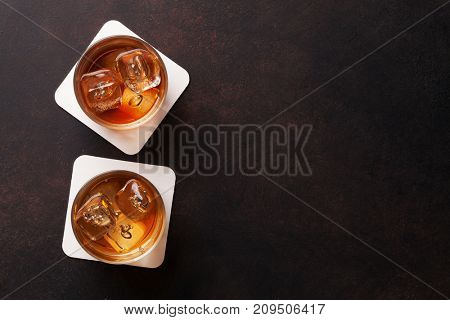 Whiskey with ice. Top view with copy space
