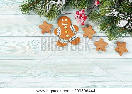 Xmas greeting card. Christmas background with snow fir tree and gingerbread cookies. View from above with space for your greetings