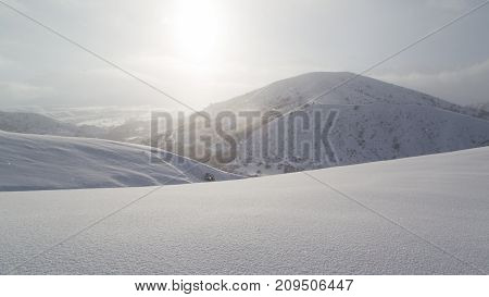 dawn sun in the snowy mountains . In the park in nature