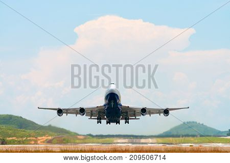 Airplane Take Off Above Airport Runway
