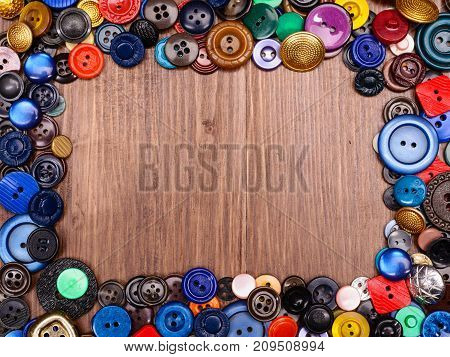 Multi Colored Old Fashion Buttons On Wooden Background