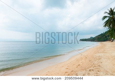 Cloudy Tropical Sea Shore With Rainy Clouds