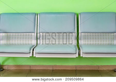 Plastic chair seats are light green, side view
