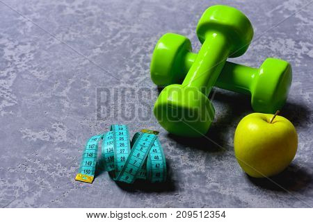 Dumbbells In Green Color, Apple And Cyan Measuring Tape