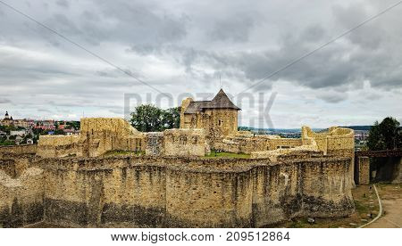 Panoramic view of the Seat Fortress of Suceava or Suceava Citadel under the cloudy sky, Romania