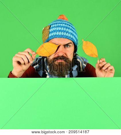 Hipster With Beard And Serious Face Wears Warm Clothes