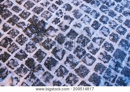 The Texture Of Paving Stone Masonry Sprinkled With Snow, Close Up.