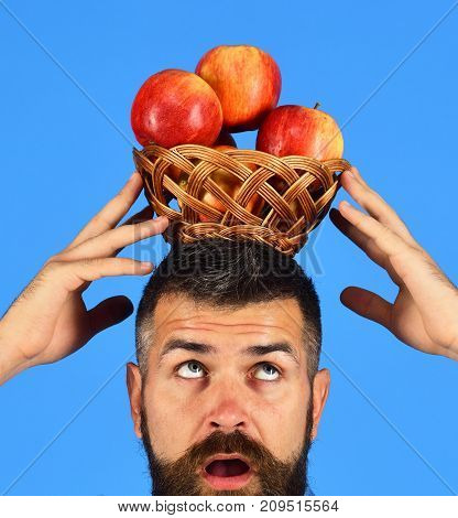 Guy Presents Homegrown Harvest. Farmer With Concentrated Face