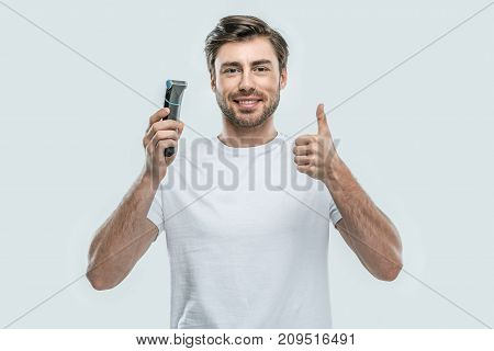 Man With Electric Razor