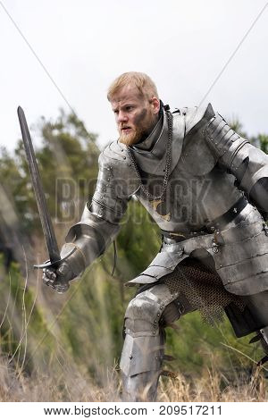 Knight In Armour During Battle On Forest Background